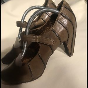 TSUBO, brownish, olive heels with black trim.
